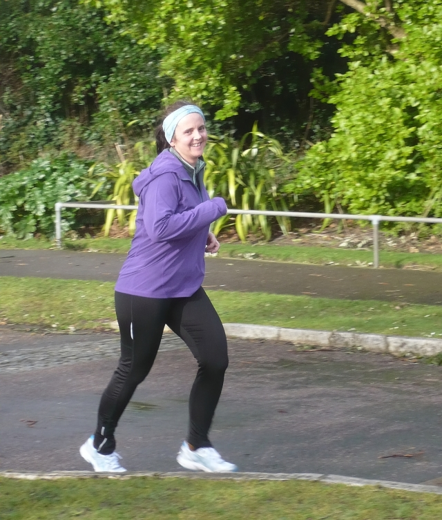 Carole comes in to finish her parkrun 5km - complete  with a lovely smile!