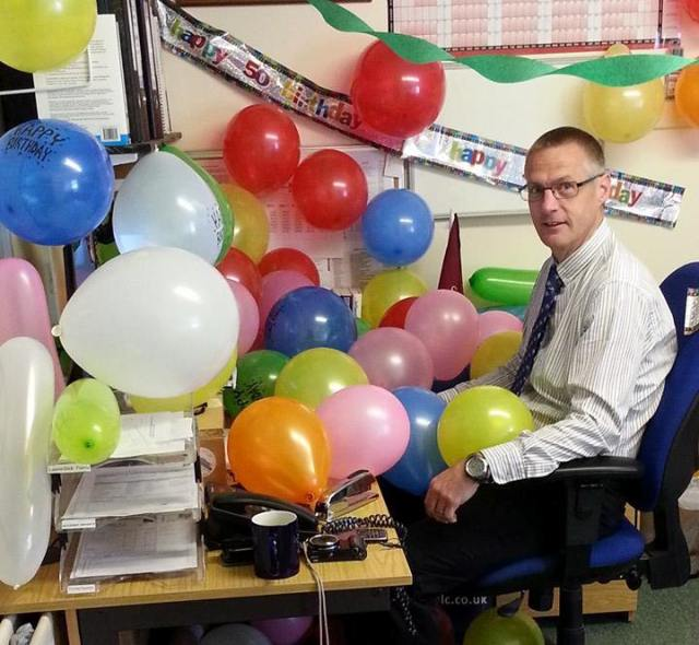 Not even balloons and streamers can keep me from my desk!