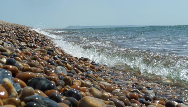 Chesil Beach, looking towards Portland. Note the lack of fish leaping out the water..