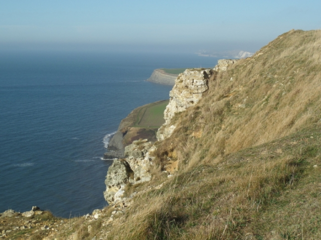 Looking West along the coastline, from Houns Tout