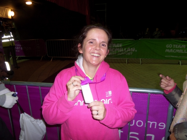 Carole, with race bling after completing the Speed of Light 5km.